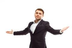 L'homme d'affaires bel répand ses bras Images stock