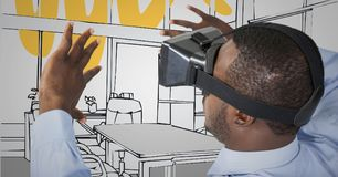 L'homme d'affaires dans le casque de réalité virtuelle distribue contre le bureau tiré par la main gris et jaune Photo stock