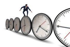 L'homme d'affaires dans le concept de gestion du temps photographie stock