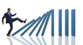 L'homme d'affaires dans le concept d'affaires d'effet de domino Photographie stock