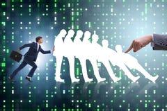 L'homme d'affaires dans le concept d'affaires d'effet de domino Photo stock