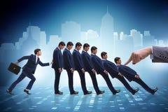 L'homme d'affaires dans le concept d'affaires d'effet de domino Photos stock