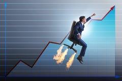 L'homme d'affaires dans le concept financier de croissance Photo stock