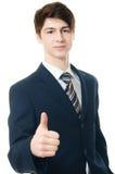 L'homme d'affaires dans le costume étire la main images libres de droits