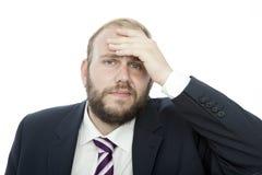 L'homme d'affaires de barbe avec la main sur la tête est malade Photo libre de droits