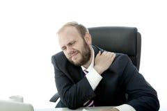 L'homme d'affaires de barbe a la douleur cervicale Photos stock