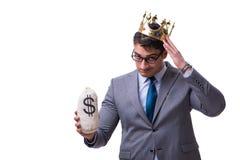 L'homme d'affaires de roi jugeant le sac d'argent d'isolement sur le fond blanc image libre de droits