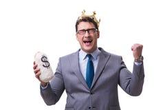 L'homme d'affaires de roi jugeant le sac d'argent d'isolement sur le fond blanc photos libres de droits