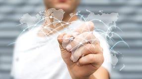 L'homme d'affaires dessinant le réseau global et les échanges de données '3D les déchirent Photo libre de droits