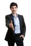 L'homme d'affaires donne sa main pour une prise de contact image stock