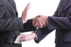 L'homme d'affaires donnent à argent pour la corruption une quelque chose mais un peop différent photos libres de droits