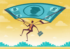 L'homme d'affaires emploie son dollar financier Bill Parachute illustration libre de droits