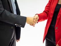 L'homme d'affaires et la femme se serrent la main Photographie stock