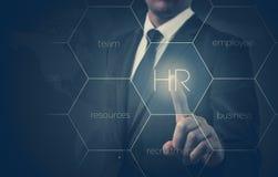 L'homme d'affaires indique l'icône-heure, le recrutement et le concept choisi photos libres de droits
