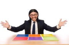 L'homme d'affaires jugeant des carnets d'isolement sur le blanc Images stock