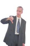 L'homme d'affaires manie maladroitement vers le bas Photos libres de droits