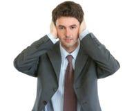 L'homme d'affaires moderne n'entendent aucun mal Photographie stock libre de droits