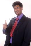 l'homme d'affaires montrant des pouces lèvent le geste sur le blanc Photographie stock