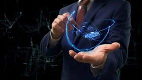 L'homme d'affaires montre le casque de l'hologramme 3d VR de concept sur sa main photos libres de droits