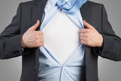L'homme d'affaires ouvrent sa chemise Image libre de droits