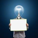 L'homme d'affaires principal de lampe avec vide écrivent le panneau Image libre de droits