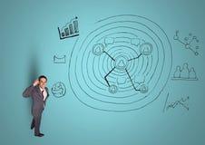 L'homme d'affaires réfléchi avec des affaires gribouille sur le fond bleu photographie stock libre de droits