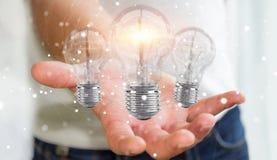 L'homme d'affaires reliant les ampoules modernes aux connexions 3D ren Images stock