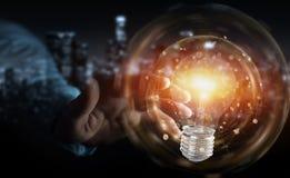 L'homme d'affaires reliant les ampoules modernes aux connexions 3D ren Images libres de droits