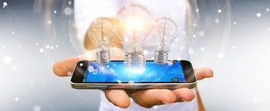 L'homme d'affaires reliant les ampoules modernes aux connexions 3D ren Image stock