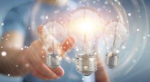 L'homme d'affaires reliant les ampoules modernes aux connexions 3D ren Photo stock