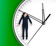 L'homme d'affaires s'arrête sur une flèche d'horloge Photographie stock