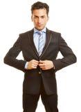 L'homme d'affaires se boutonne vers le haut de son costume Photos libres de droits
