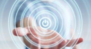 L'homme d'affaires tenant 3D rendent le bouton de puissance avec sa main Photo stock