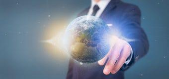 L'homme d'affaires tenant des particules d'un rendu 3d mettent à la terre le globe Photos stock