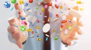 L'homme d'affaires tenant et touchant les pilules de flottement 3D de médecine les déchirent Photos stock