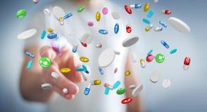 L'homme d'affaires tenant et touchant les pilules de flottement 3D de médecine les déchirent Photographie stock