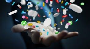 L'homme d'affaires tenant et touchant les pilules de flottement 3D de médecine les déchirent Images stock