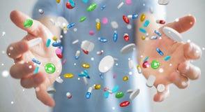 L'homme d'affaires tenant et touchant les pilules de flottement 3D de médecine les déchirent Photo stock