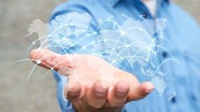 L'homme d'affaires tenant le réseau global et les échanges de données '3D les déchirent Photo stock