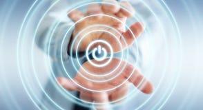 L'homme d'affaires tenant 3D rendent le bouton de puissance avec sa main Image libre de droits
