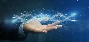 L'homme d'affaires tenant un 3d rendent l'ADN Image libre de droits