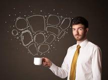L'homme d'affaires tenant une tasse blanche avec la parole bouillonne Image libre de droits