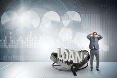 L'homme d'affaires tombant dans le piège du crédit de prêt Photographie stock libre de droits