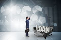 L'homme d'affaires tombant dans le piège du crédit de prêt Image stock