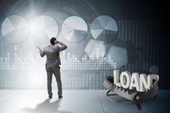 L'homme d'affaires tombant dans le piège du crédit de prêt Photo libre de droits