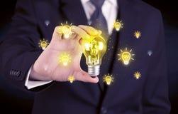 L'homme d'affaires a un concept lumineux d'idée Photographie stock