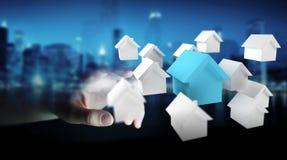 L'homme d'affaires utilisant 3D a rendu de petites maisons blanches et bleues Photos stock