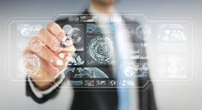L'homme d'affaires utilisant les écrans numériques avec les données 3D d'hologrammes rendent Image stock