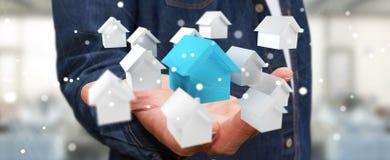 L'homme d'affaires utilisant 3D a rendu de petites maisons blanches et bleues Image stock