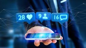 L'homme d'affaires utilisant un smartphone avec a aiment, disciple et messag Photographie stock libre de droits